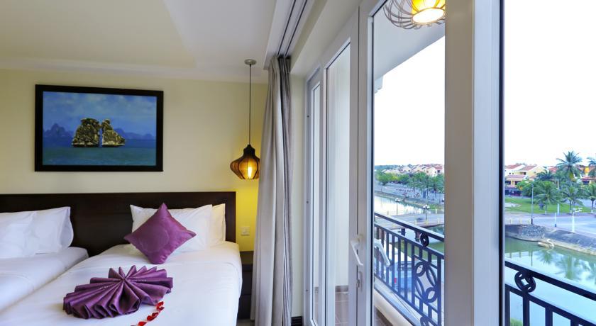 Quarto e vista do River Suites Hotel, em Hoi An, Vietnã | foto: divulgação