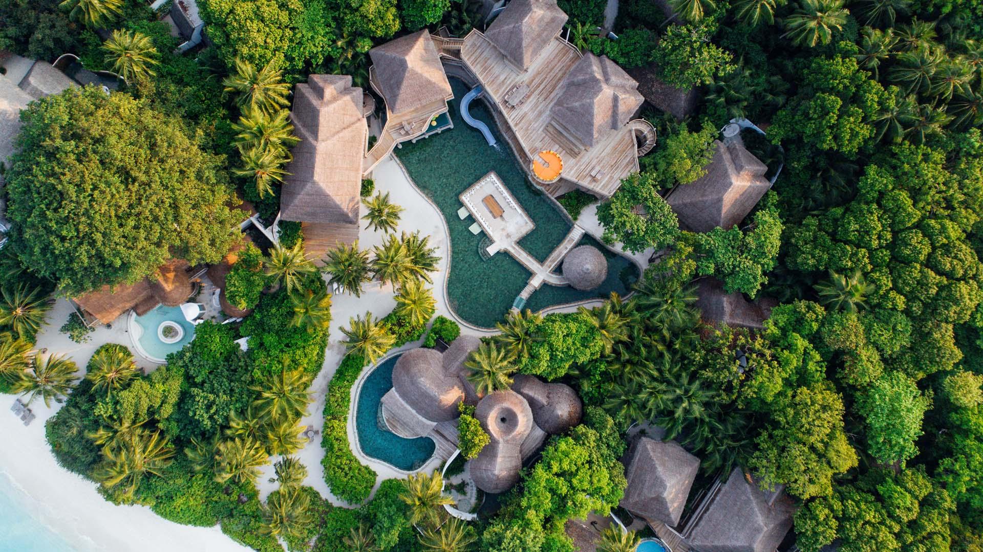 Soneva Fushi villas com piscina e toboga
